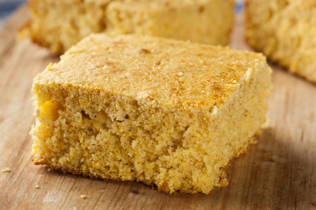 Golden Organic Homemade Cornbread cut into squares